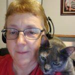 My Cat Nutmeg sitting on my shoulder.